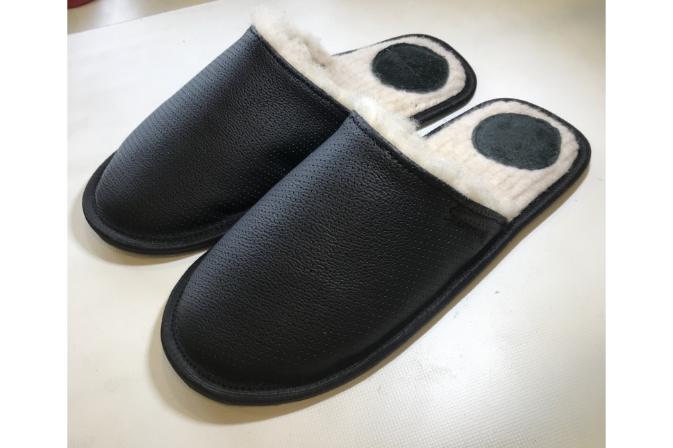 Black slippers with holes